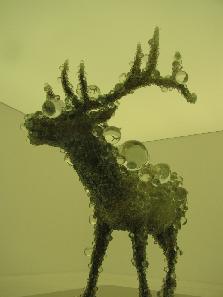 reindeer encased in glass bubbles art