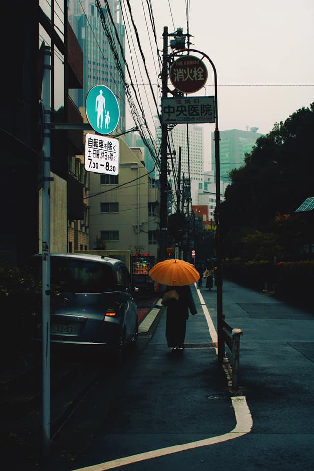street in Tokyo with umbrella