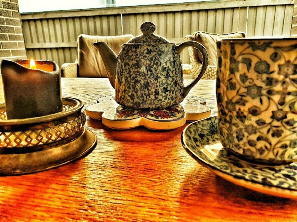 teapot with teacups and candle