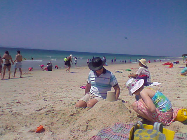 Bribie island beach australia children playing