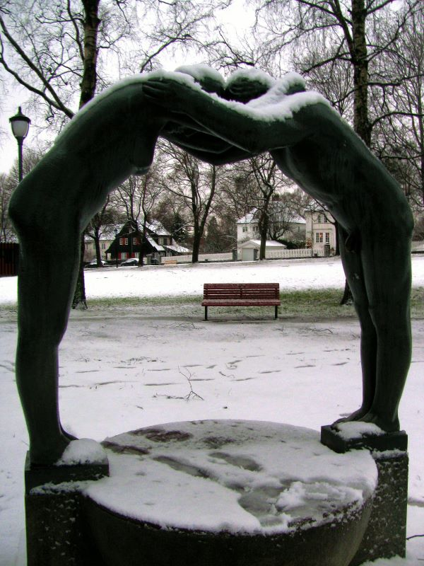 male and female statue in Vigeland Sculpture park, Norway holding arms forming an arch