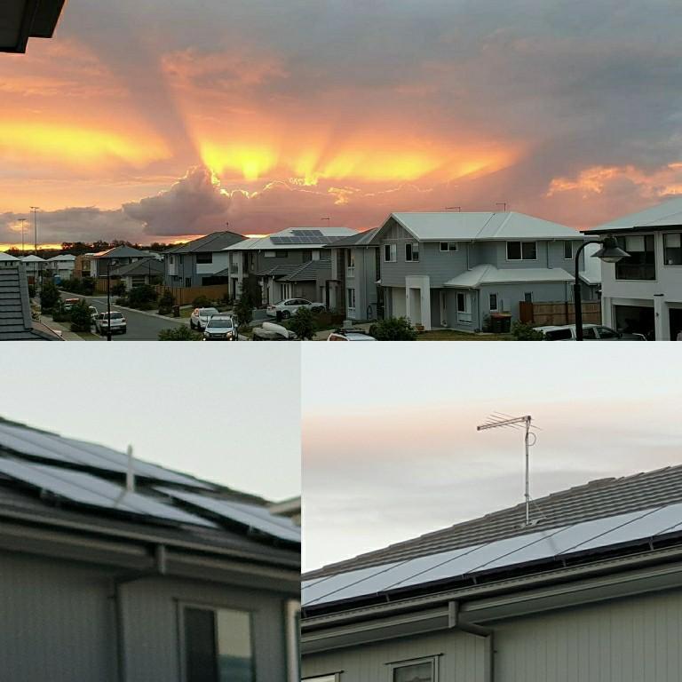 solar panels on houses with sunrise